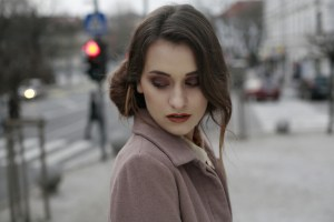 Young woman on the street looking worried