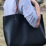 This reversible faux leather tote provides ample room to carry around your daily stuff.
