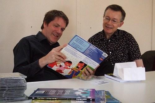 Caption 2008 guests Rian Hughes and Paul Gravett admire Woodrow's album cover art. Photo: Damian Cugley