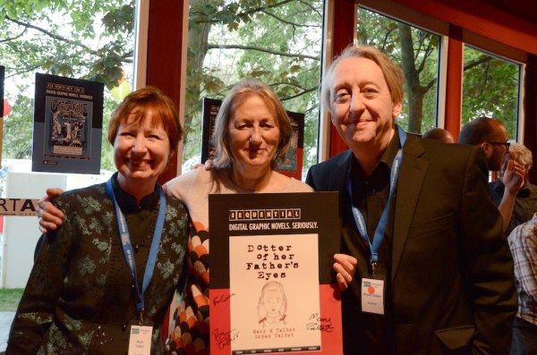 Mary Talbot (left) and Bryan Talbot (right) present a signed poster to Corinne Pearlman of Myriad Editions at the SEQUENTIAL party at the Edinburgh International Book Festival. Photo: Panel Nine
