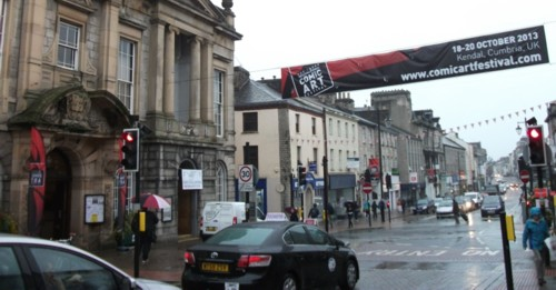 Clock Tower and Lakes Interntional Comic Art Festival 2013 Banner, Kendal