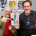 John Freeman with Rian Hughes at a London Comic Con, pictured here with a copy of 'Science Service' a project for Belgian publisher Magic Strip, John's first commercial commission as a comic writer back in the 1980s. Photo: Steve Cook
