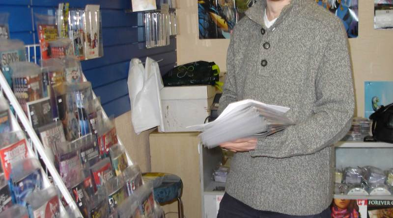 First Age Comics, Lancaster's co-owner Mark Braithwaite in the shop's new store at 13 Moor Lane, busy shelving new issues of US comics.