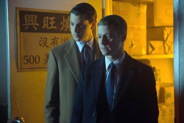 "Nicholas D'Agosto as Harvey Dent and Ben McKenzie as Detective James Gordon in ""Gotham: Everyone Has A Cobblepot"""