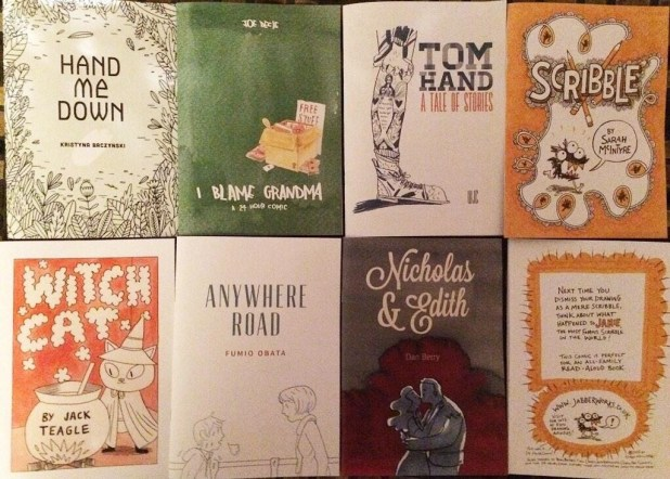 "All seven of the original 2014 LICAF 24-Hour Comic Marathon comics! (The eighth is the back cover of ""Scribble"" by Sarah McIntyre). Photo: Sarah McIntyre"