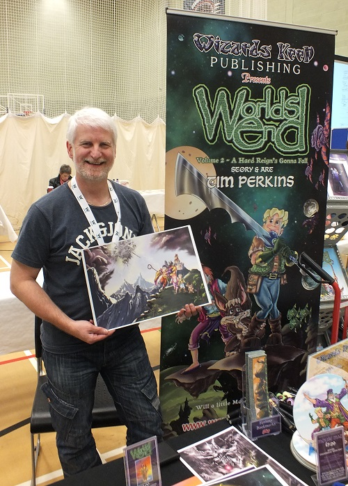 Tim Perkins shows off the wraparound cover for Volume 2 of his Worlds End GN series at Wonderlands 2015. Photo: Jeremy Briggs