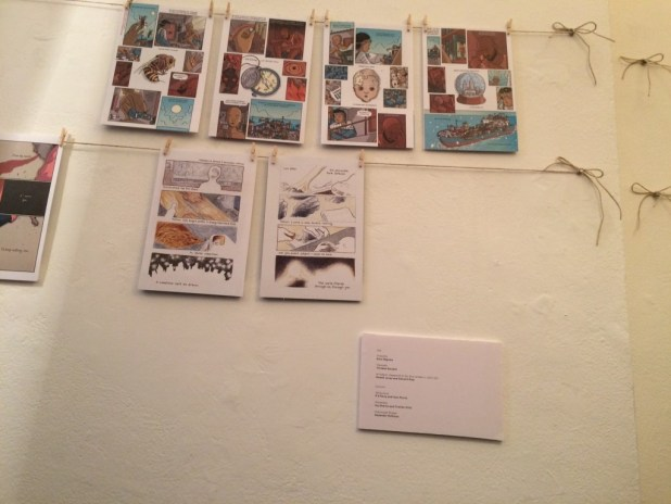 Artwork from Over the Line on display at the Poetry Cafe. The exhibition runs until the end of October 2015.
