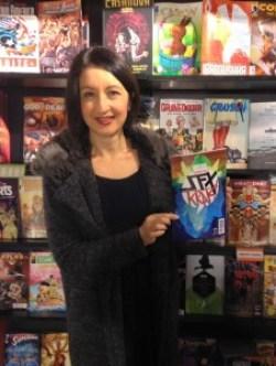 Jessica Martin with a copy of Vertigo Quarterly #3 in London's Gosh Comics. Photo courtesy Jessica Martin.