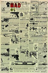 """Alfred E. Neuman's first appearance on MAD Magazine (Issue 21), the third face from viewer's left of the six faces. Via <a href=""""http://www.madcoversite.com/mad021.html"""">MAD</a>. Licensed under Fair use via <a href=""""https://en.wikipedia.org/wiki/File:MAD_Magazine_(no._21,_front_cover).jpg#/media/File:MAD_Magazine_(no._21,_front_cover).jpg"""">Wikipedia</a>."""