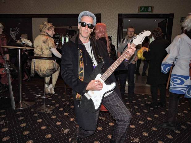Low cost cosplay: Terry Brady as the Twelfth Doctor. Talcum powder, the right gear from your wardrobe and a guitar and bob's yer uncle!