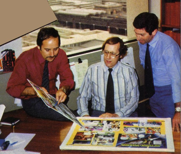 David Hunt, Barry Tomlinson and Gil Page discuss Gerry Embleton's Dan Dare artwork for the first issue of new Eagle in 1982