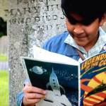 "Nikhil Prasad (Yadav Ganatra) reads Legends of the Cosmos in the Father Brown episode ""Fire in the Sky"""