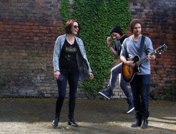 Rehearsals are Fun with East of Eli, seen here bopping in the back garden of the Casbah Club, Liverpool, with Johann Frank guitar player to the stars and beyond. Photo courtesy Tim Quinn