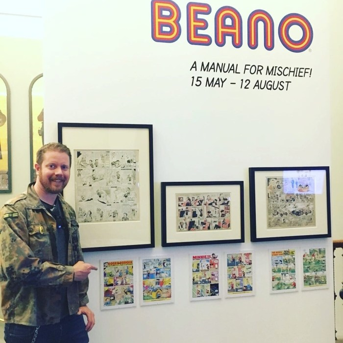 "Comics writer and editor Danny Pearson discovers one of his ""Roger the Dodger"" strips, drawn by Barry Appleby, in the V&A exhibition. Photo courtesy Danny Pearson"