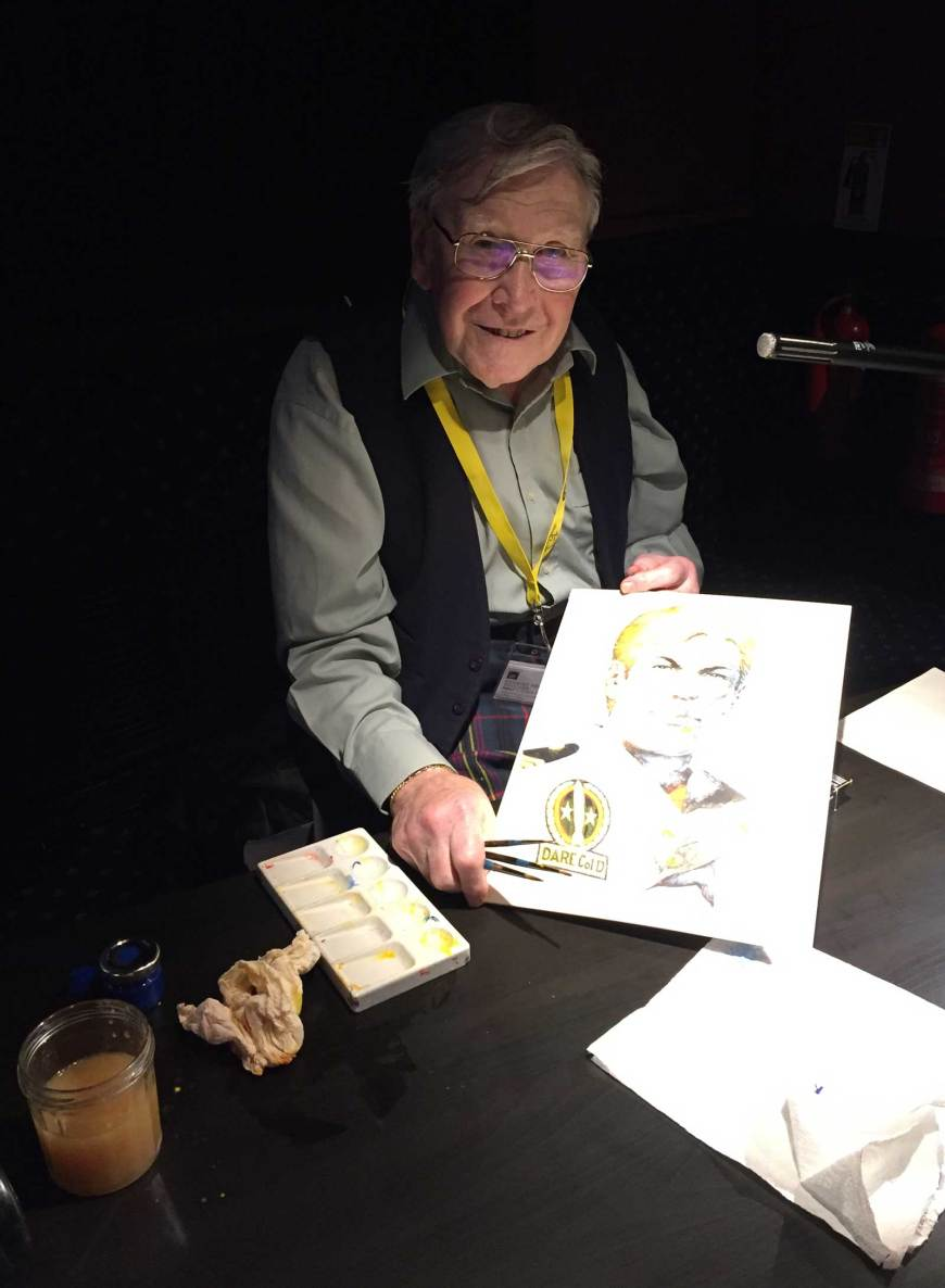 Ian Kennedy with the Dan Dare art he coloured on stage