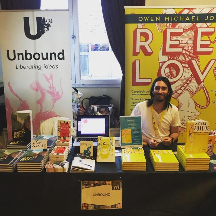 Reel Love author Owen Michael Johnson on the Unbound stand at the Lakes International Comic Art Festival 2018. Photo: Unbound