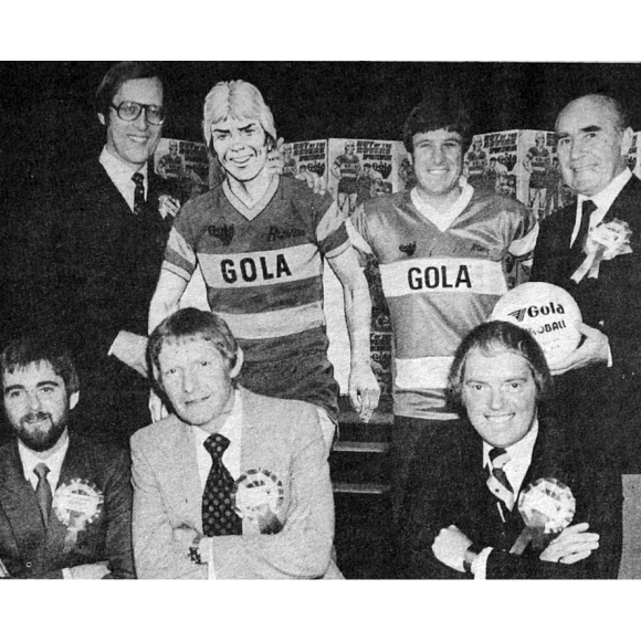 The original Gola launch event in the 1980s. Quite a line-up! Front row, left to right: editor Ian Vosper, writer Tom Tully, artist David Sque. Back row: Group editor Barrie Tomlinson, Roy, Emlyn Hughes, Sir Alf Ramsey. Photo courtesy Barrie Tomlinson