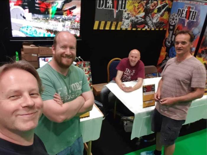 Dave and Adrian Clarke of GetMyComics with Simon Furman and Geoff Senior at MCM in 2019. Photo courtesy Adrian Clarke