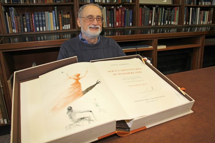 Stuart Rothstein, a retired Brock chemistry and physics professor, donated a rare version of Alice's Adventures in Wonderland, illustrated by Salvador Dali, to Brock University's Special Collections in 2017. Image: Brock University