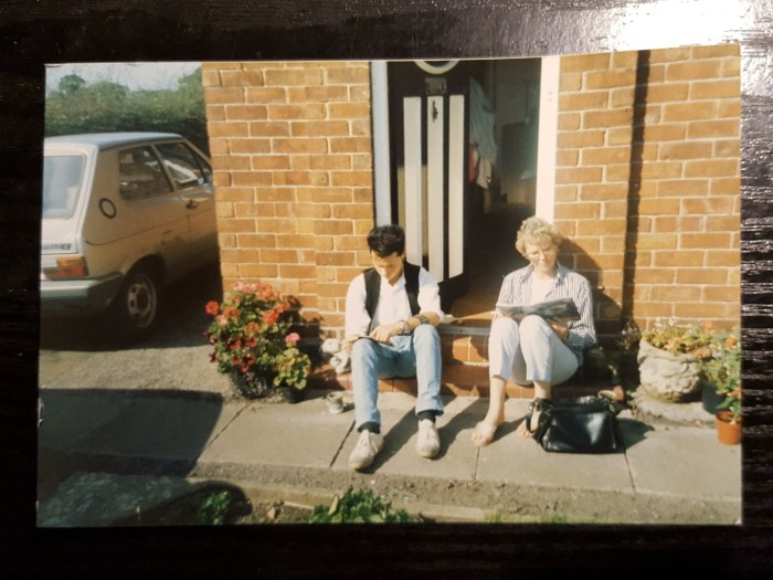 A young Stephen L. Holland reading comics with his Mum!