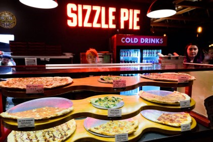Sizzle Pie pizza offers by the slice, meaty, vegetarian, vegan and gluten free options. Photo by Mike Higdon