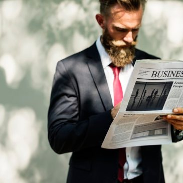 A corporate boss reading the business news