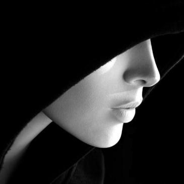 A woman in a black hood.