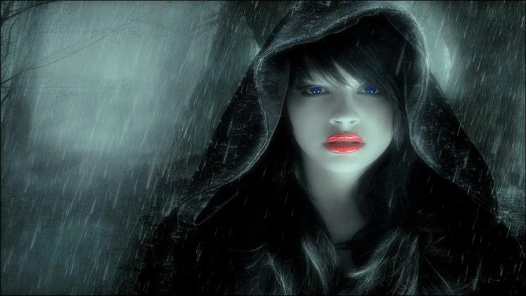 A woman in a dark hood.
