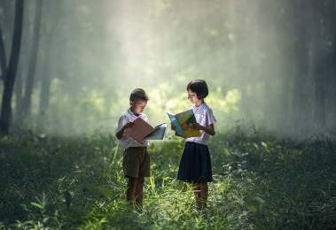 Two young students in a forest