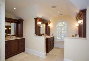 wood vanities and marble tile