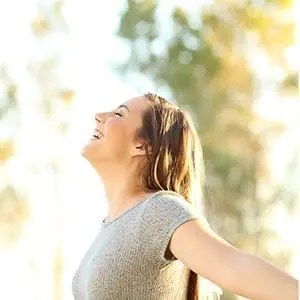 Treating mental health with a CDH account; woman smiling