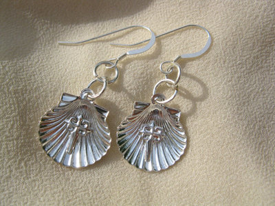 Scallop shell earrings with St James cross for safekeeping