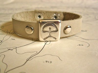 Indalo charm bracelet ~ natural leather strap, ecru