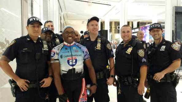 Dallas Police Officer and Sergeant First Class, Fredie Cohen, poses with members of NYPD who supported the Ride 2 Recovery challenge. Over 200 riders passed through New York City on their way to their final stop to Annapolis, Maryland.