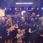 Members of the Dallas Police Command Staff pose with Dallas Police Star of Texas Award recipients and their families.