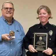 Robert Hursh, the Community Representative for the Dallas Police Awards Committee, introduces and presents Senior Corporal Hannah Tamez #8518 as the Oak Cliff Lions Club's Officer of the Month for the month of October.