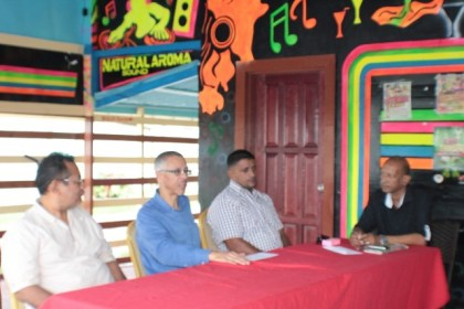 (From left to right) Minister of Business Dominic Gaskin (second from left) with Vice- Chairman of West Berbice Chamber of Commerce, Angad Ganesh and members of the Chamber of Commerce.