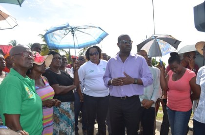 Minister of Public Infrastructure, David Patterson along with Minister within the Ministry, Annette Ferguson listening to Region Five residents' concerns