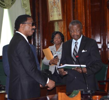 Attorney General and Minister of Legal Affairs Basil Williams hands over a copy of the COI report to Speaker of the National Assembly Dr. Barton Scotland.