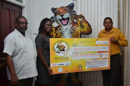 GAICO Construction and General Services' Representative, Francesca Peters (center) presents a $500,000 cheque to Guyana Tourism Authority's Director, Indranauth Haralsingh (right) and Permanent Secretary to the Ministry of Public Telecommunications, Derrick Cummings (left)