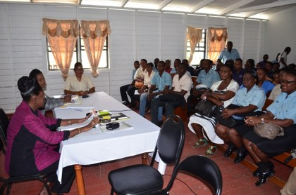 """Minister within the Ministry of Communities, Valerie Sharpe-Patterson addressing the ranks at the """"Meet the Public,"""" exercise at the Leonora Police Station"""