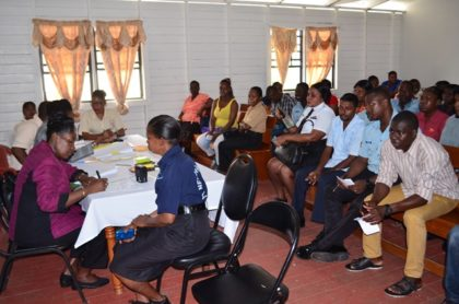 """Minister within the Ministry of Communities, Valerie Sharpe-Patterson taking a rank through the process, at the Ministry of Communities-Department of Housing """"Meet the Public,"""" exercise at the Leonora Police Station"""
