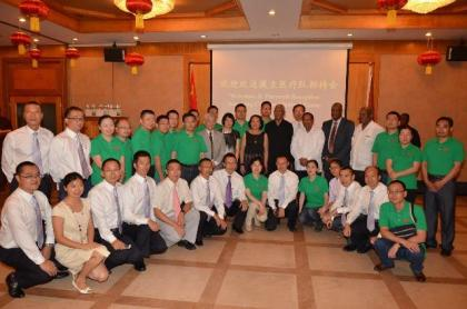 The outgoing Chinese Medical Brigade and their successors (in green shirts) with second row-fourth from right: Minister of Finance, Mr. Winston Jordan, Minister of State, Mr. Joseph Harmon, Prime Minister, Mr. Moses Nagamootoo, President David Granger, First Lady, Mrs. Sandra Granger, wife of the Chinese Ambassador to Guyana, Ms. Liu Yu and Chinese Ambassador to Guyana, Mr. Zhang Limin