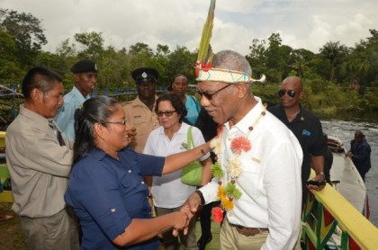 President David Granger is welcomed by Headmistress of the St. Francis Primary School, Moraikobai, Ms. Shalome Calistro, upon his arrival to the village .