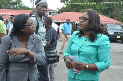 Minister in the Ministry of Public Health, Dr Karen Cummings in discussion with a Regional Health official at the health fair held at the Mackenzie car park