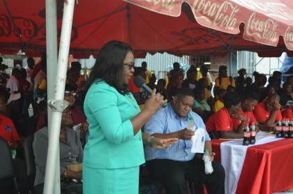 Minister in the Ministry of Public Health, Dr Karen Cummings addressing attendees at the health fair at the Mackenzie car park