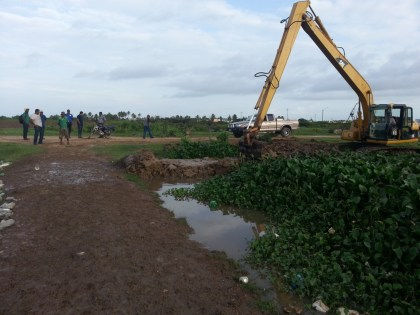 Excavator clearing channel