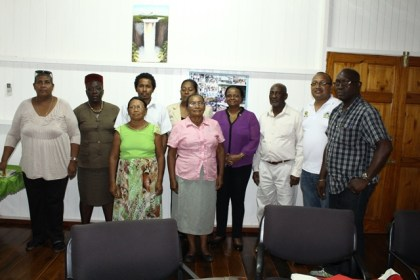 Minister of Social Protection Volda Lawrence, Minister within the Ministry, Keith Scott, Members of Parliament, Rajcoomarie Bancroft and Desmond Adams, and Chief Social Services Officer Ricardo Banwarie flanked by members of the Region 8 Board of Guardians