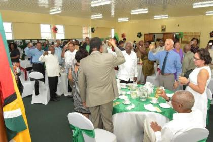 Prime Minister, Moses Nagamootoo, Ministers of Government and other Government officials proposing a toast to the continue good health and wellbeing of the President.