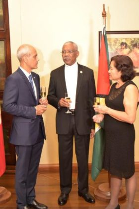 President David Granger, French Ambassador to Guyana, Mr. Michael Prom and First Lady, Mrs. Sandra Granger in discussion at the reception, which was held this evening in observance of France's National Day.